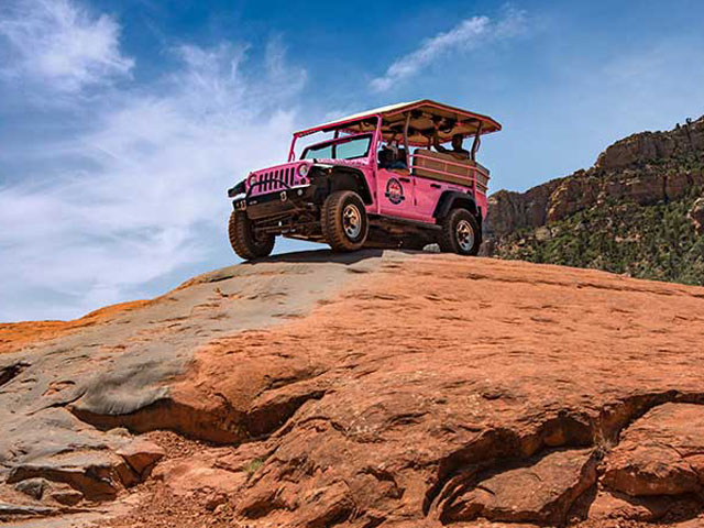 Jeep tour on the red rocks via Pink Adventure Tours.