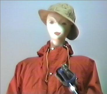 Mannequin in ski gear holding ski poles