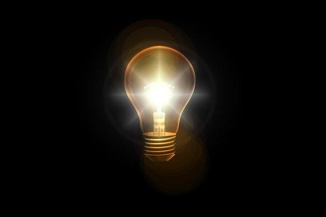 Lightbulb in dark void.