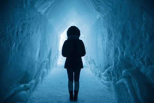 Woman in a ice tunnel
